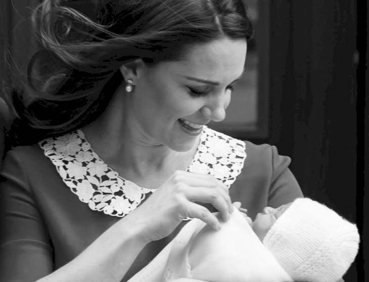 Image Credit: Getty Images / Catherine, Duchess of Cambridge departs the Lindo Wing with her newborn son, Prince Louis.