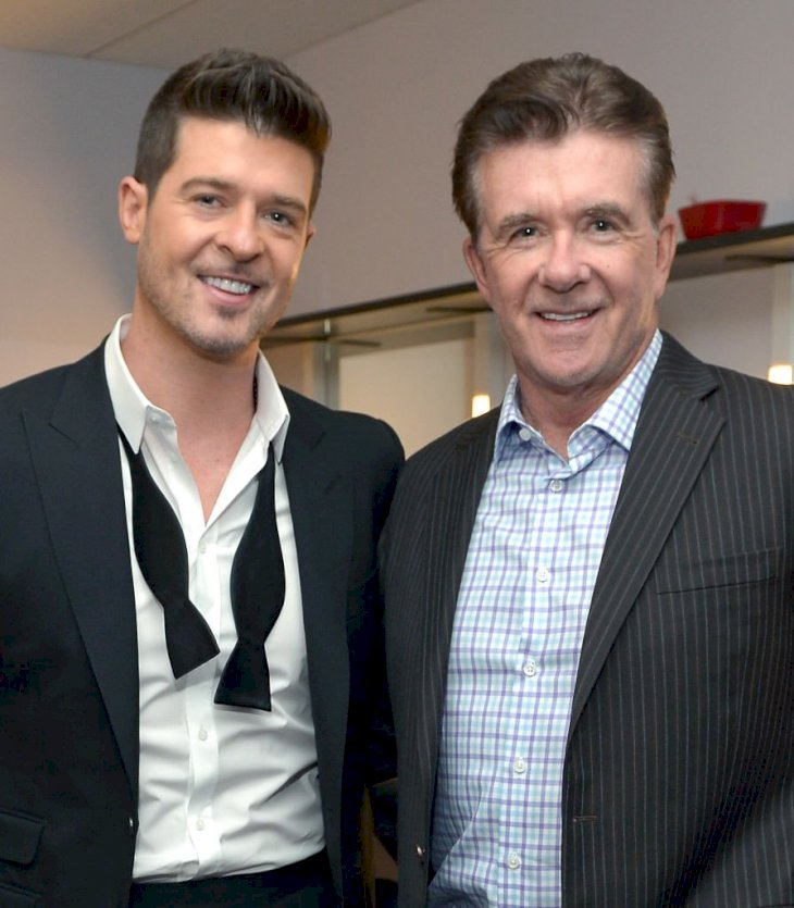 Image Credits: Getty Images / Charley Gallay / WireImage | Recording artist Robin Thicke and actor Alan Thicke attend The GRAMMY Nominations Concert Live!! Countdown to Music's Biggest Night at Nokia Theatre L.A. Live on December 6, 2013 in Los Angeles, California.