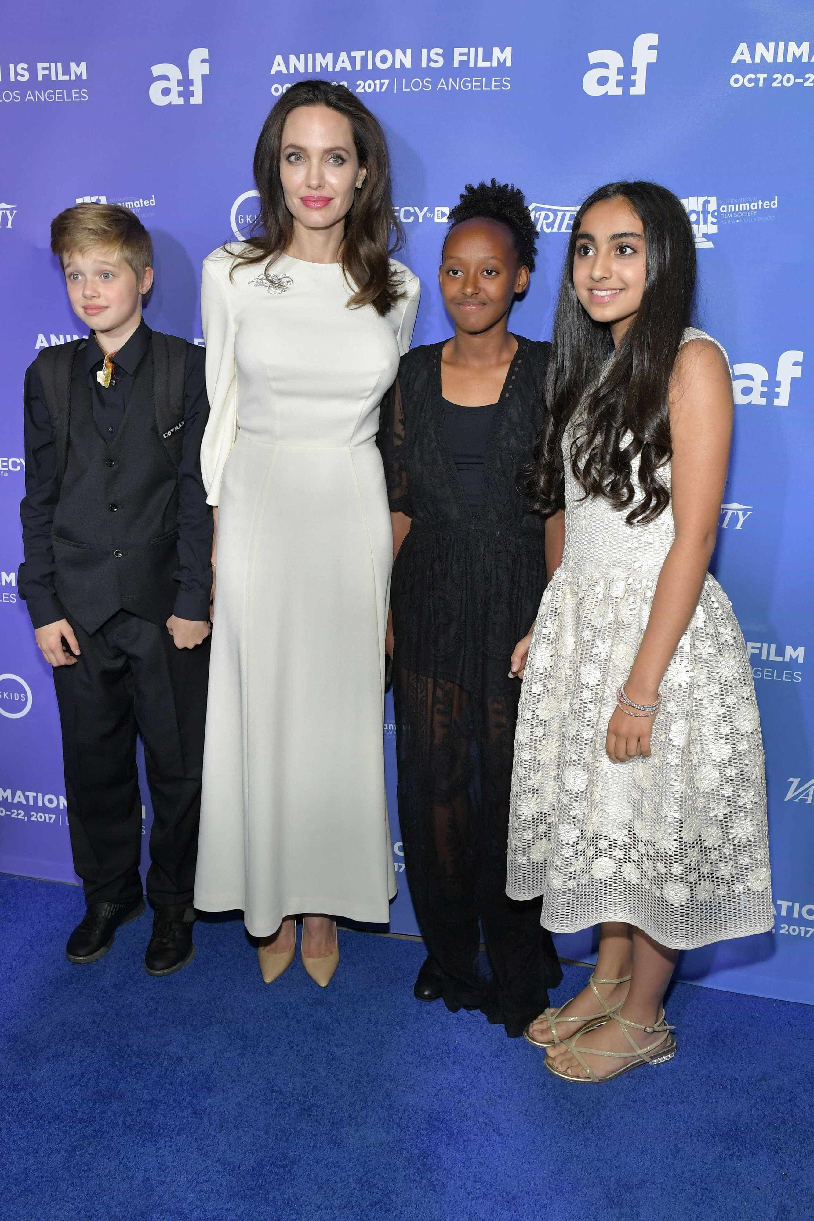 Image Source: Getty Images/Jolie with the kids