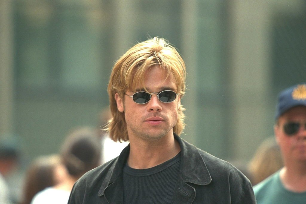 Image Credit: Getty Images / Brad Pitt on the set of a movie in 1996.