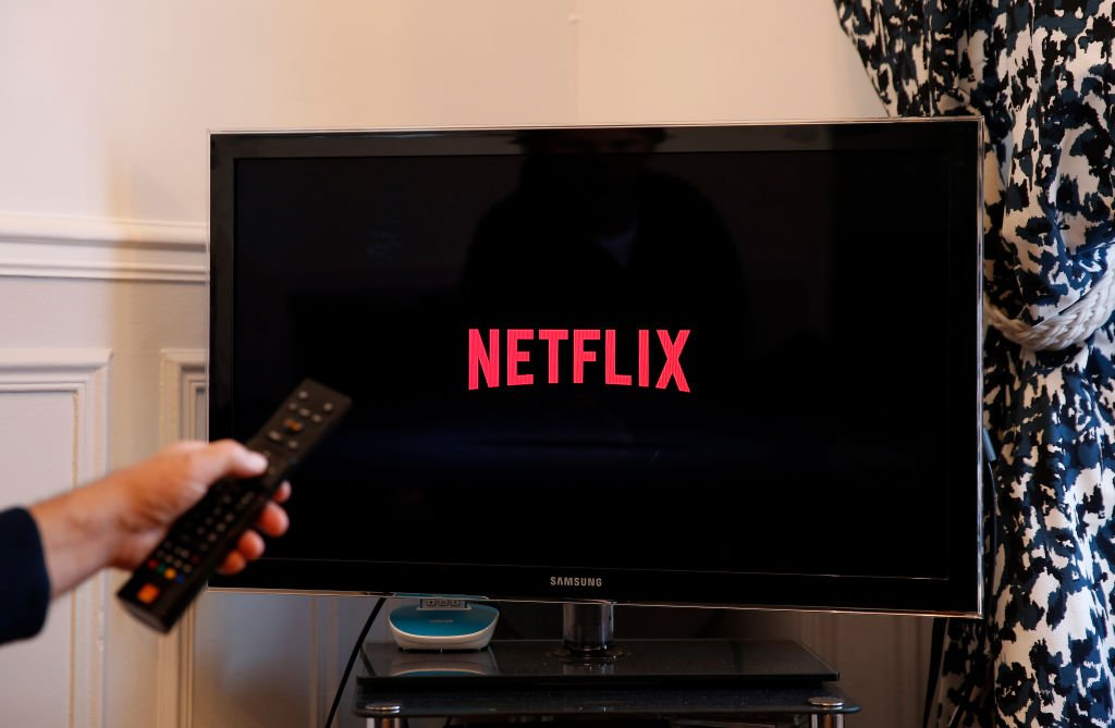 Image Credits: Getty Images / Illustration by Chesnot | In this photo illustration, the Netflix media service provider's logo is displayed on the screen of a television on October 23, 2018 in Paris, France.