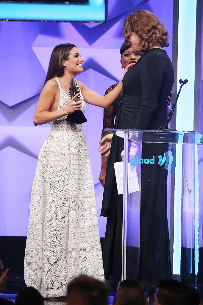 Image Credits: Getty Images / Michael Tran / FilmMagic | Lilly Wachowski speaks onstage with Keke Palmer and Lea Michele during the 27th Annual GLAAD Media Awards held at The Beverly Hilton Hotel on April 2, 2016 in Beverly Hills, California.