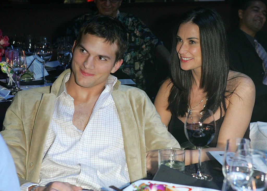 Image Credits: Getty Images / Chris Polk / FilmMagic | Ashton Kutcher and Demi Moore during Ubid.com Joins Forces with Hollywood Stars to Launch Celebrity Auction to Benefit Hurricane Victims - Inside at Empire Ballroom in Las Vegas, Nevada, United States.