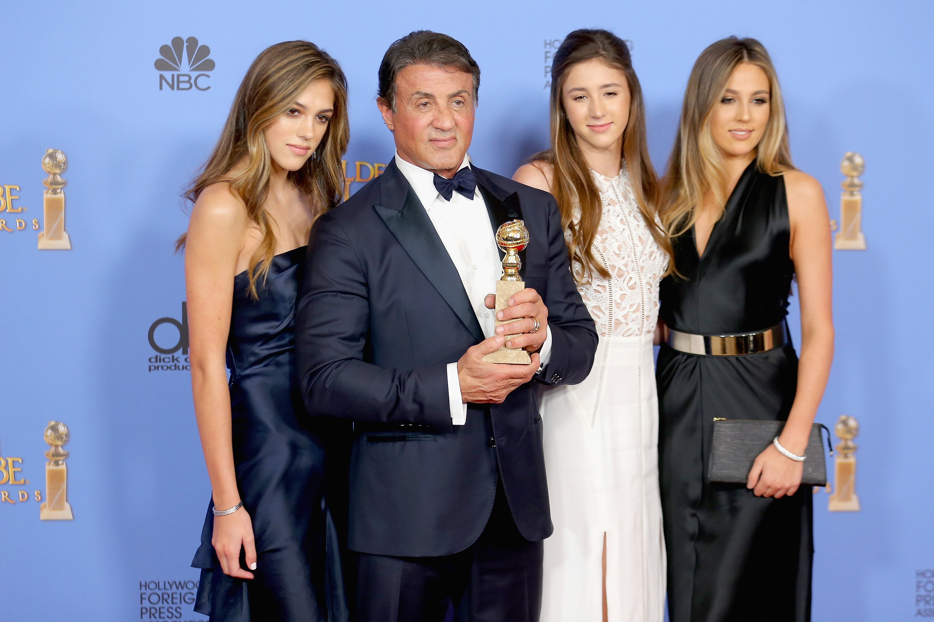Image Credits: Getty Images / Mark Davis | Actor Sylvester Stallone (2nd L), winner of Best Supporting Performance in a Motion Picture for 'Creed,' poses in the press room with daughters Sistine, Sophia and Scarlet during the 73rd Annual Golden Globe Awards held at the Beverly Hilton Hotel on January 10, 2016 in Beverly Hills, California.