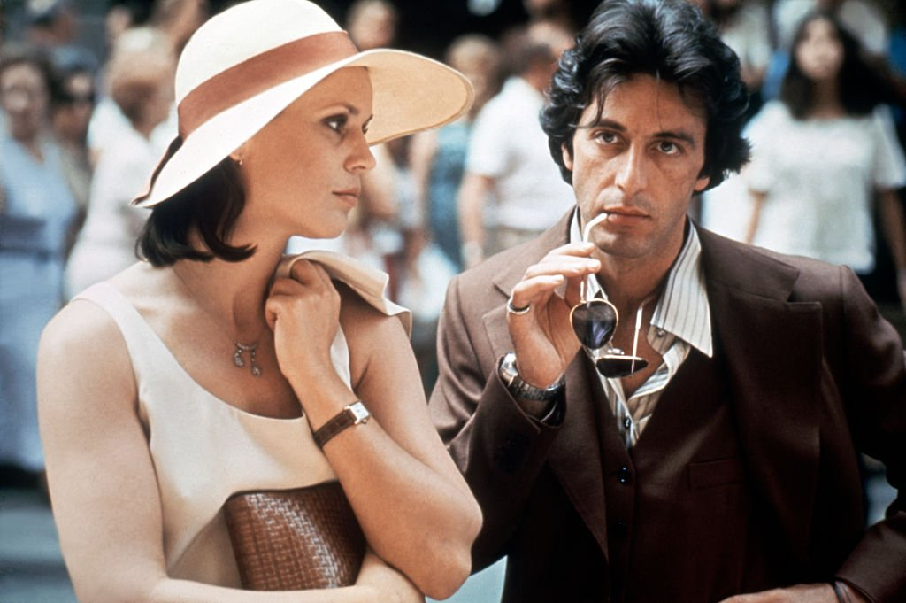 Image Credit: Getty Images/Corbis via Getty Images/Sunset Boulevard | Pacino and Martha Keller on the set of Bobby Deerfield