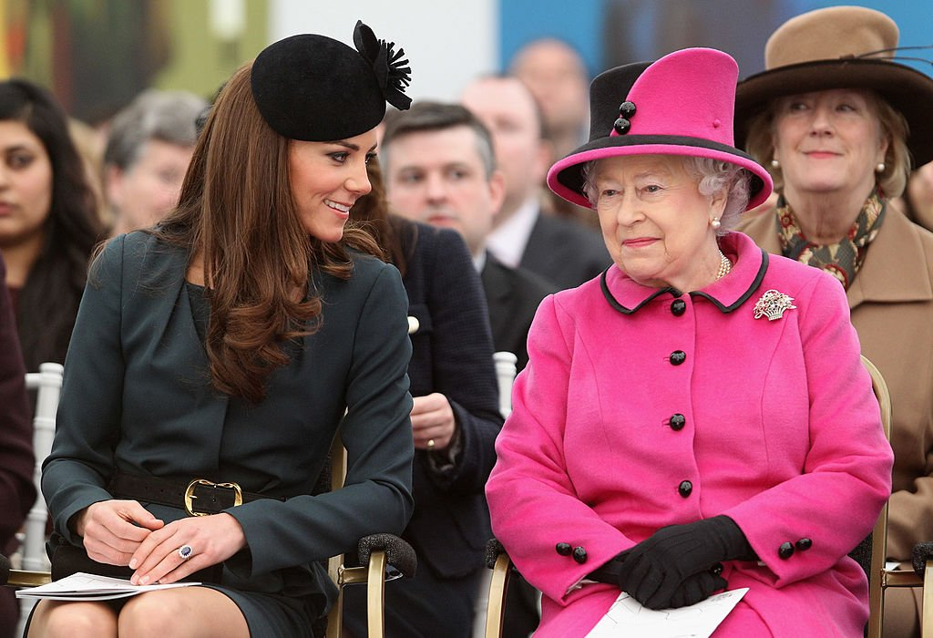 Image Credit: Getty Images / Queen Elizabeth II (R) and Catherine, Duchess of Cambridge (L) watch a fashion show at De Montfort University on March 8, 2012 in Leicester, England.