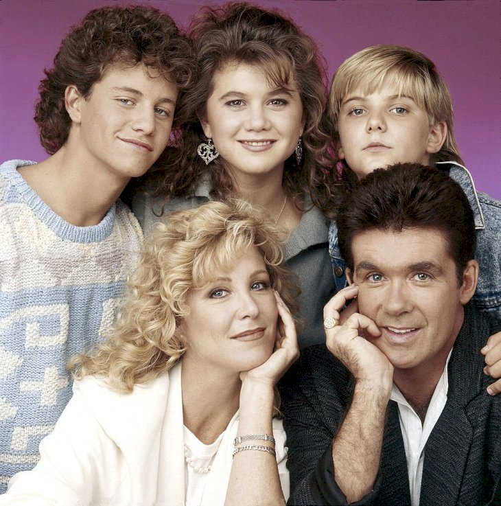 "Image Credits: Getty Images / Walt Disney Television | The cast of sitcom ""Growing Pains""."