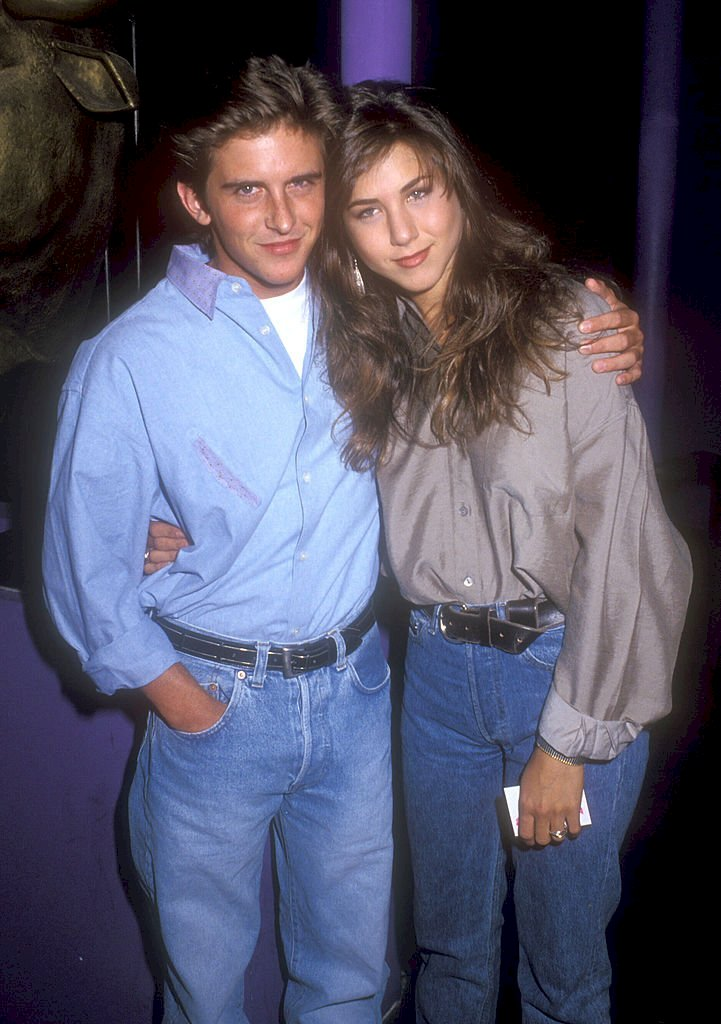 Image Credit: Getty Imagse/WireImage/Barry King | Charlie Schlatter and Jennifer Aniston in 1990