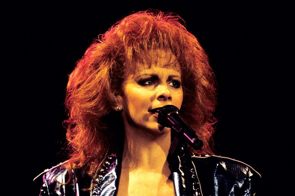 Image Credit: Getty Images / Acclaimed singer and actress, Reba McEntire on stage.