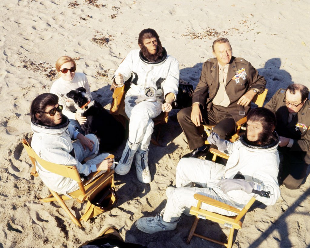 Actors Roddy McDowall as Cornelius, Kim Hunter as Zira, Natalie Trundy as Dr. Stephanie Branton, Harry Lauter as General Winthrop and Sal Mineo as Milo in the science-fiction film 'Escape from the Planet of the Apes', 1971 | Image Source: Getty Images