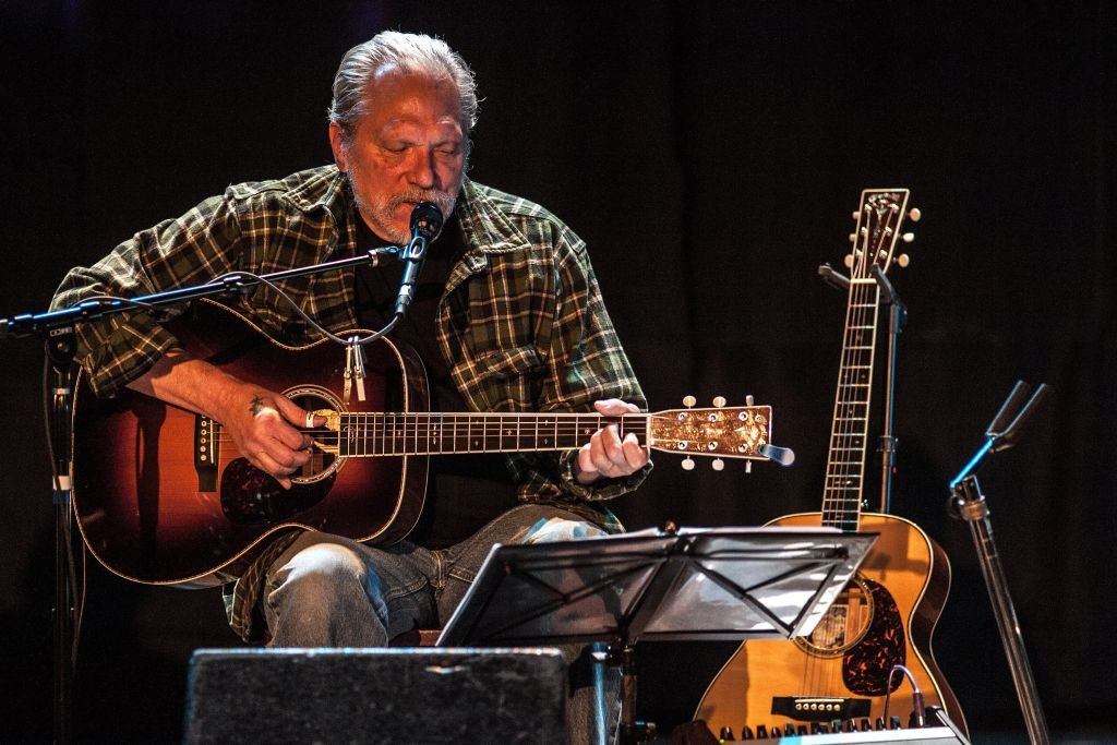Image Credits: Getty Images / Larry Hulst / Michael Ochs Archives | Jorma Kaukonen performing with 'Hot Tuna' at the Oriental Theater in Denver, Colorado on February 23, 2014.