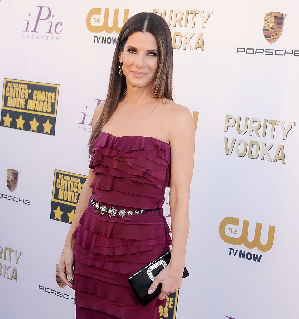 Image Credits: Getty Images / Gregg DeGuire / WireImage | Actress Sandra Bullock arrives at the 19th Annual Critics' Choice Movie Awards at Barker Hangar on January 16, 2014 in Santa Monica, California.