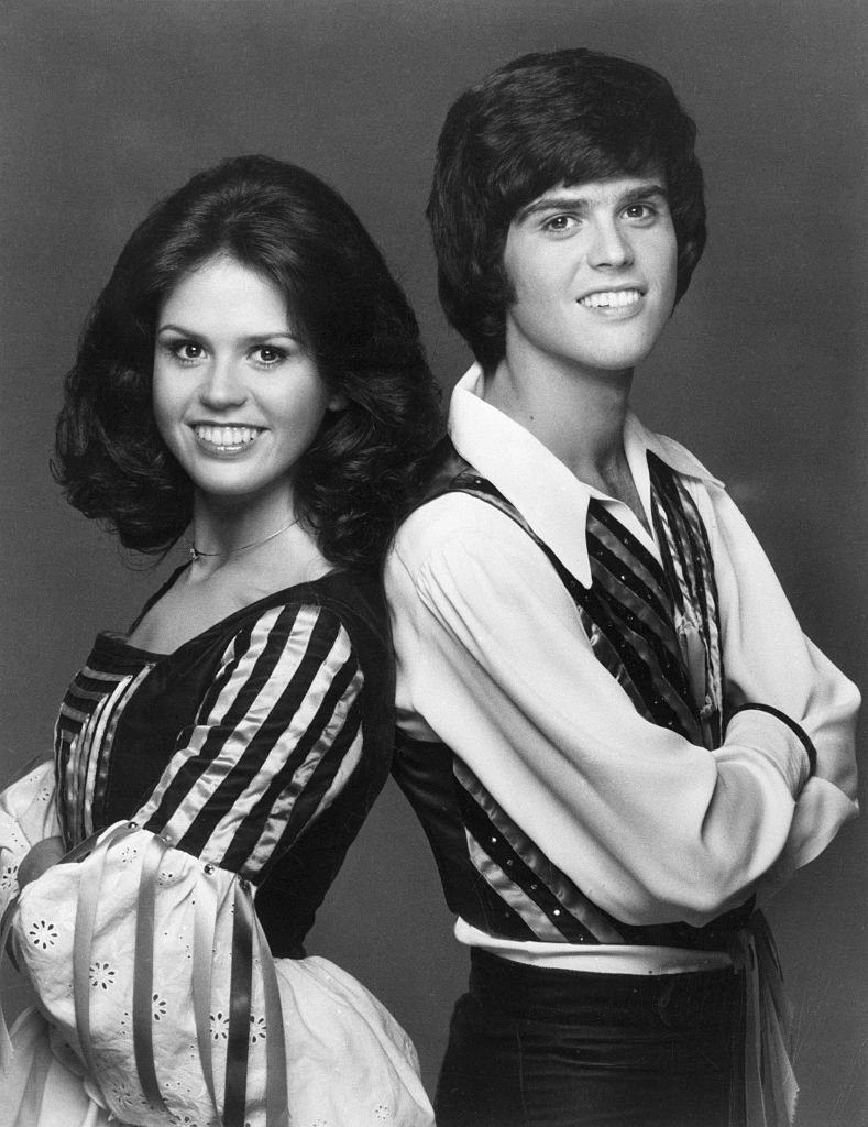 Image Credits: Getty Images / Bettmann | Portrait of sibling singers Donny and Marie Osmond, 1975.