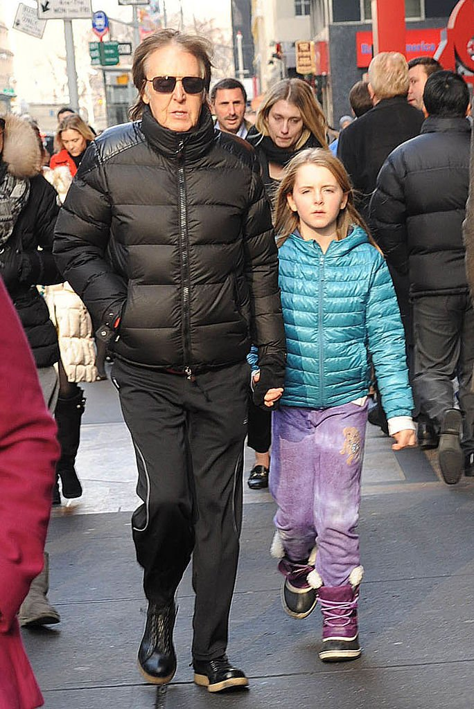 Image Credits: Getty Images / Demis Maryannakis / Star Max / FilmMagic | Musician Sir Paul McCartney and his daughter, Beatrice McCartney, are seen on December 19, 2013 in New York City.