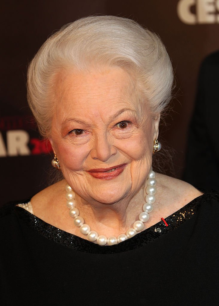Image Credits: Getty Images /  Toni Anne Barson | Olivia de Havilland arrives at the 36th Cesar Awards at Theatre du Chatelet
