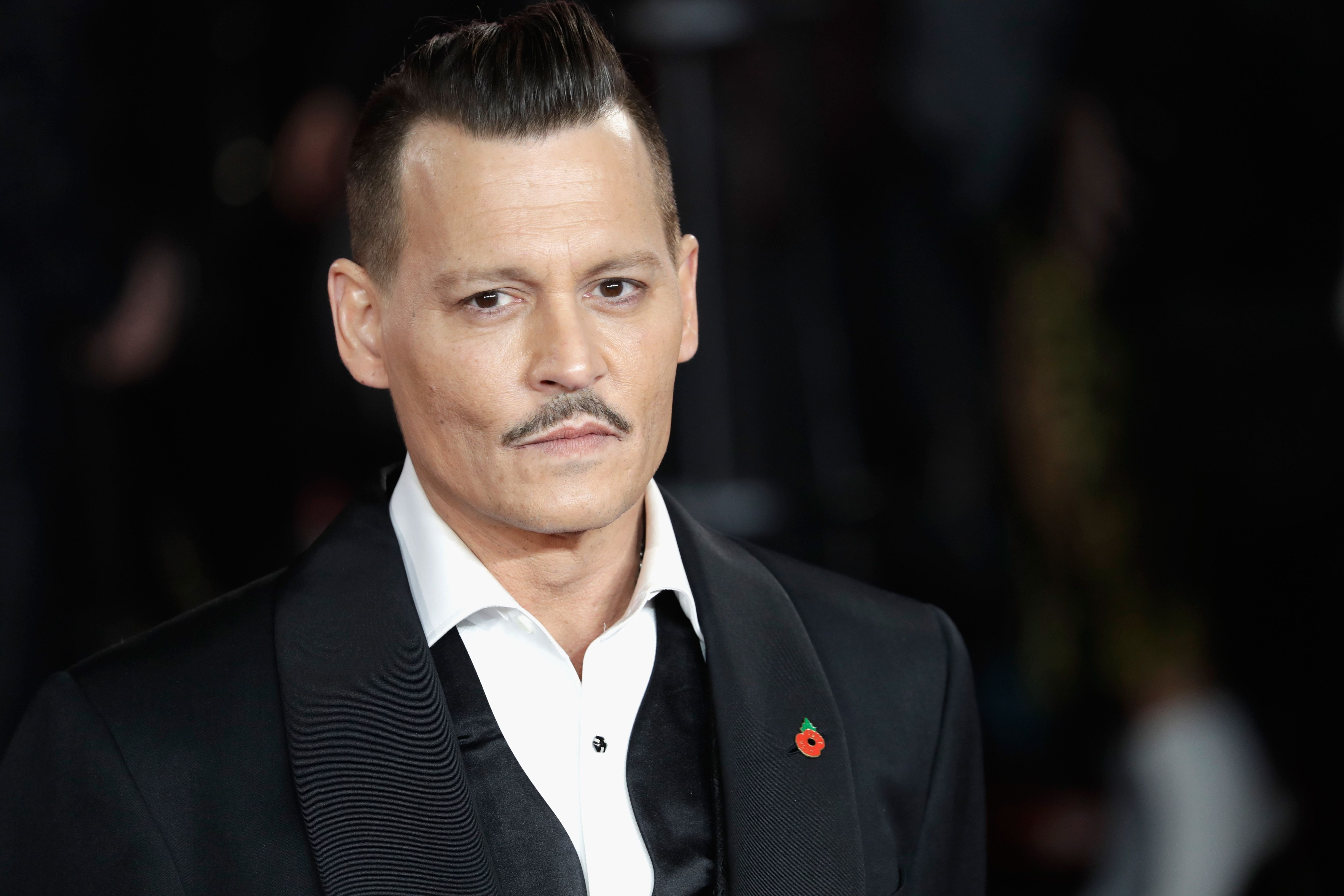 Johnny Depp at the World Premiere of Murder in Orient Express / Getty Images
