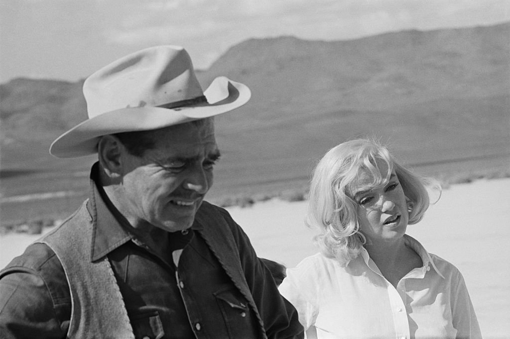 Image Credit: Getty Images / American actors Clark Gable and Marilyn Monroe during the location shoot of 'The Misfits' in the Nevada Desert, 1960.