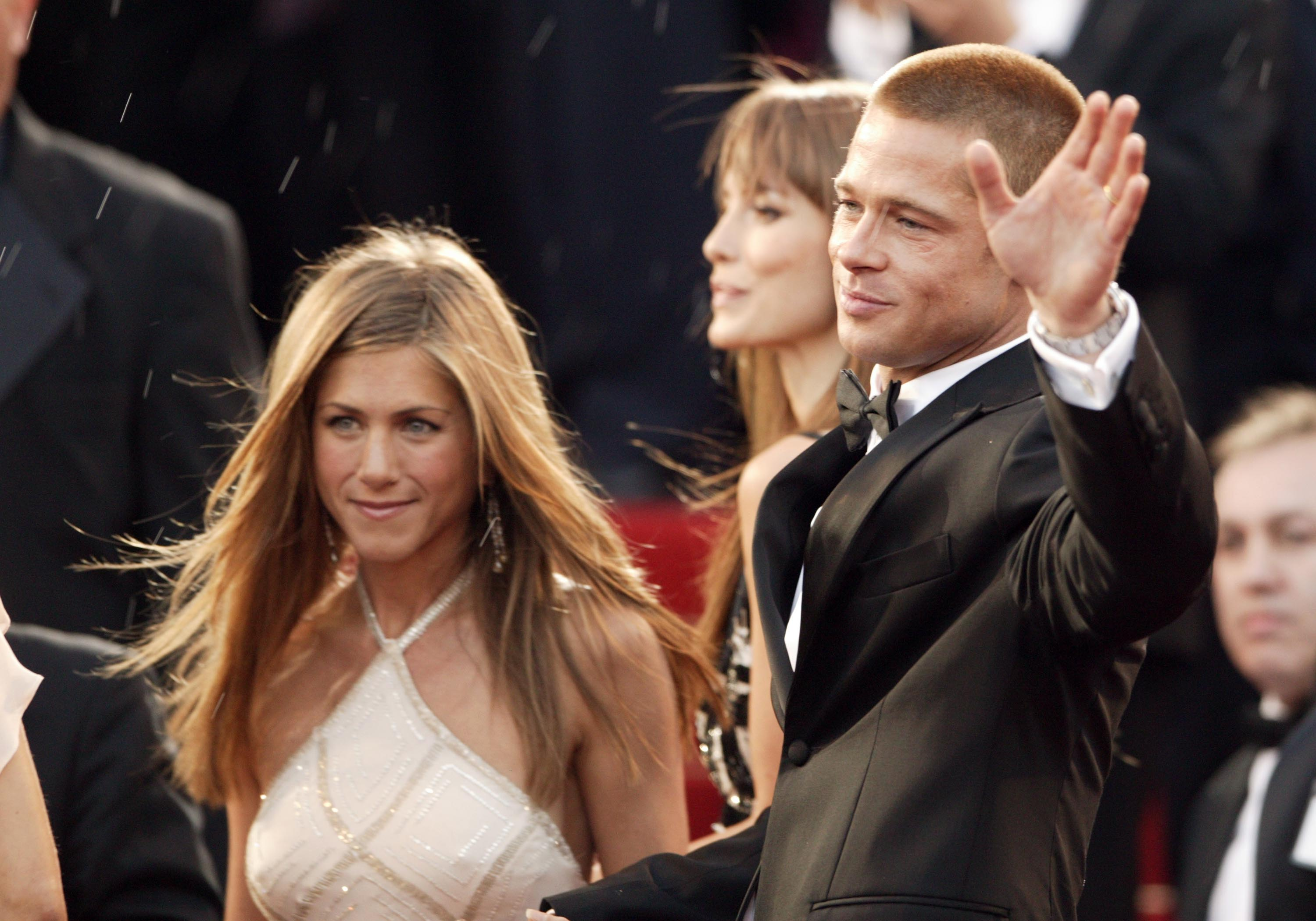 "Image Credits: Getty Images / Dave Hogan | Actors Brad Pitt and Jennifer Aniston attend the World Premiere of epic movie ""Troy"" at Le Palais de Festival on May 13, 2004 in Cannes, France."