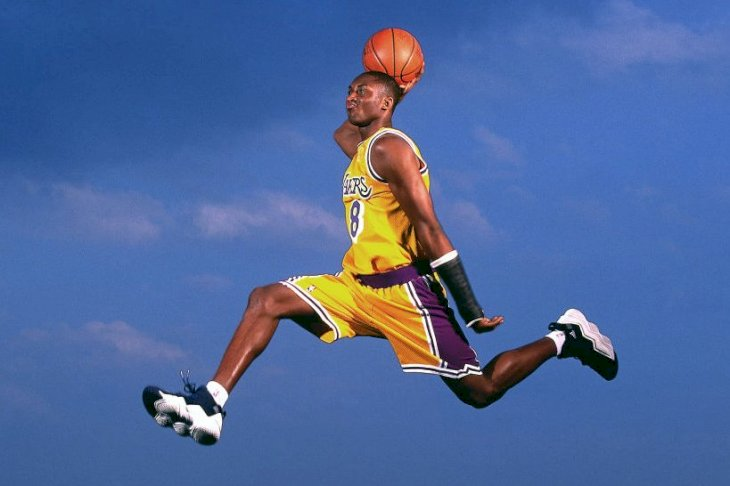 Image Credits: Getty Images / Walter Iooss Jr. / NBAE | Kobe Bryant #8 of the Los Angeles Lakers poses for an action portrait during a photo shoot session in 1997 in Los Angeles, Callifornia.