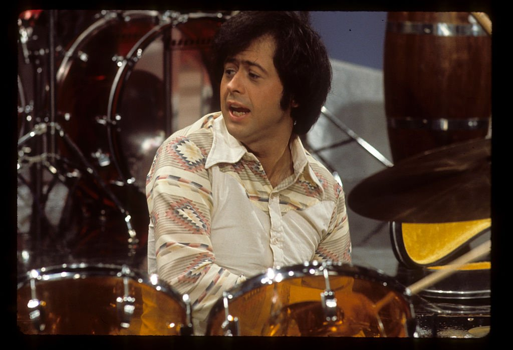Image Credit: Getty Images / Wayne Osmond plays drums for his siblings in April 2, 1976.