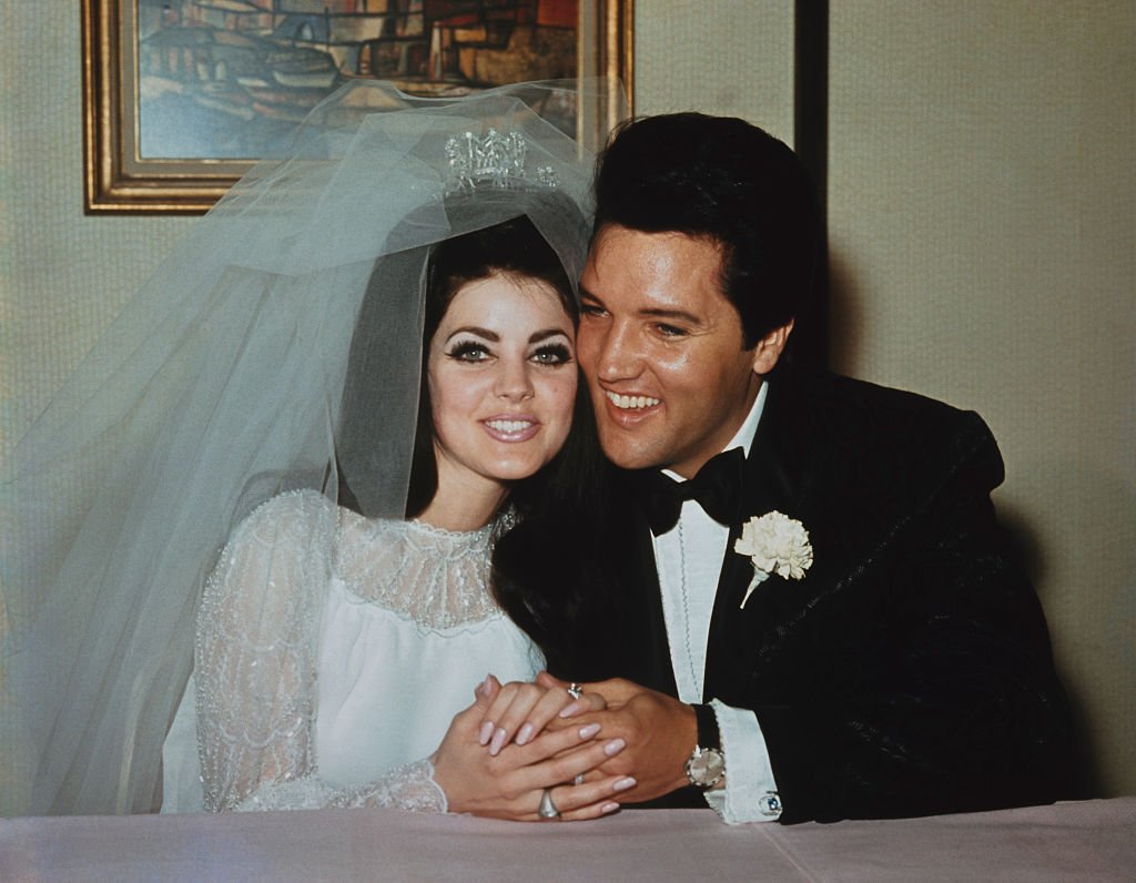 Image Source: Getty Images/Popperfoto via Getty Images/Rolls Press | Elvis and Priscilla on their wedding day