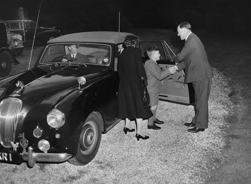Image Credit: Getty Images / Prince Charles arrives at Cheam School in Berkshire to start his first term, and is introduced to the headmaster, Peter Beck, 23rd September 1957.