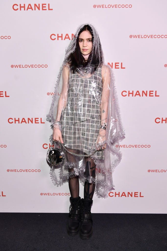 Image Credit: Getty Images / Grimes, wearing Chanel, attends a Chanel Party to celebrate the Chanel Beauty House on February 28, 2018 in Los Angeles, California.
