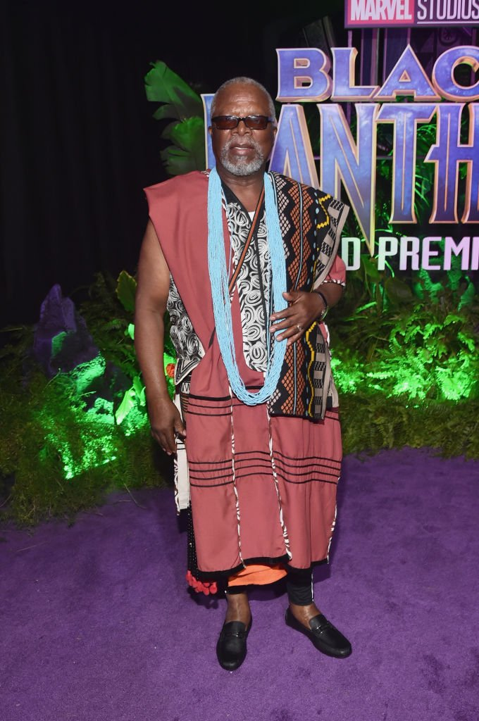 Image Credits: Getty Images / Alberto E. Rodriguez | Actor John Kani at the Los Angeles World Premiere of Marvel Studios' BLACK PANTHER at Dolby Theatre on January 29, 2018 in Hollywood, California.