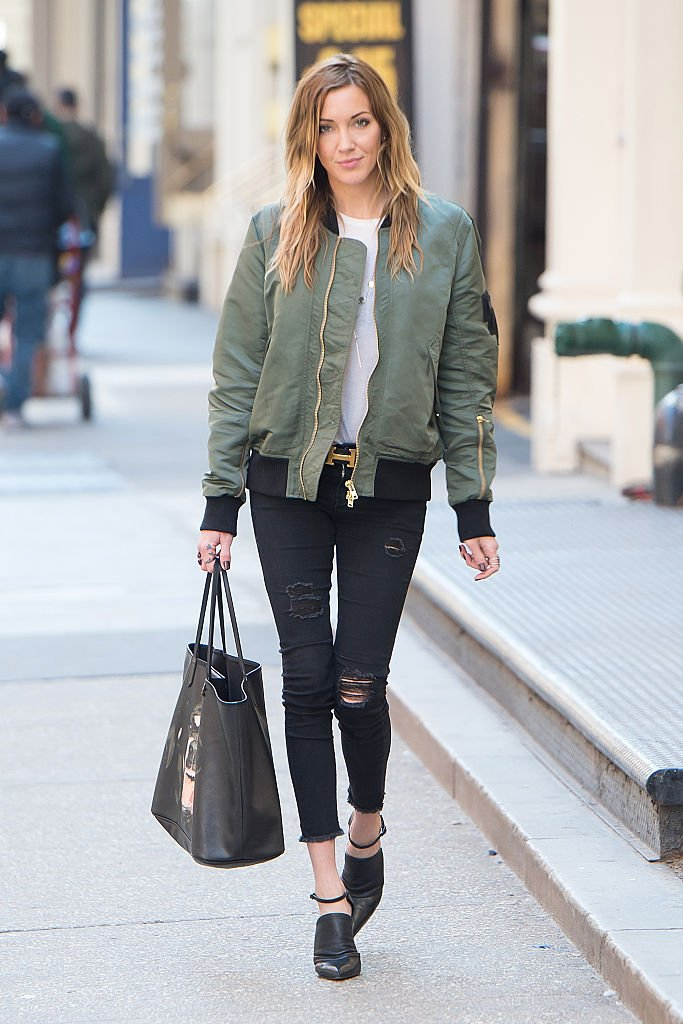 Image Source: Getty Images/ Kati Cassidy walking down the street