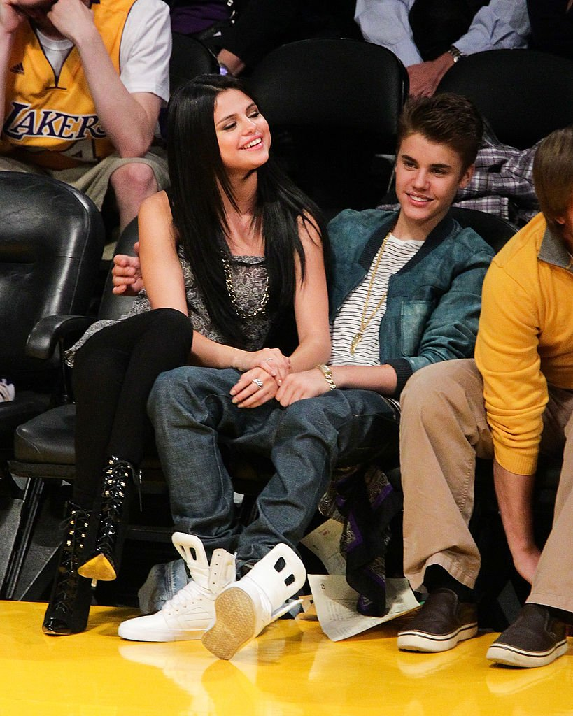 Image Source: Getty Images/Noel Vasquez/Selena Gomez (L) and Justin Bieber attend a basketball game between the San Antonio Spurs and the Los Angeles Lakers at Staples Center on April 17, 2012