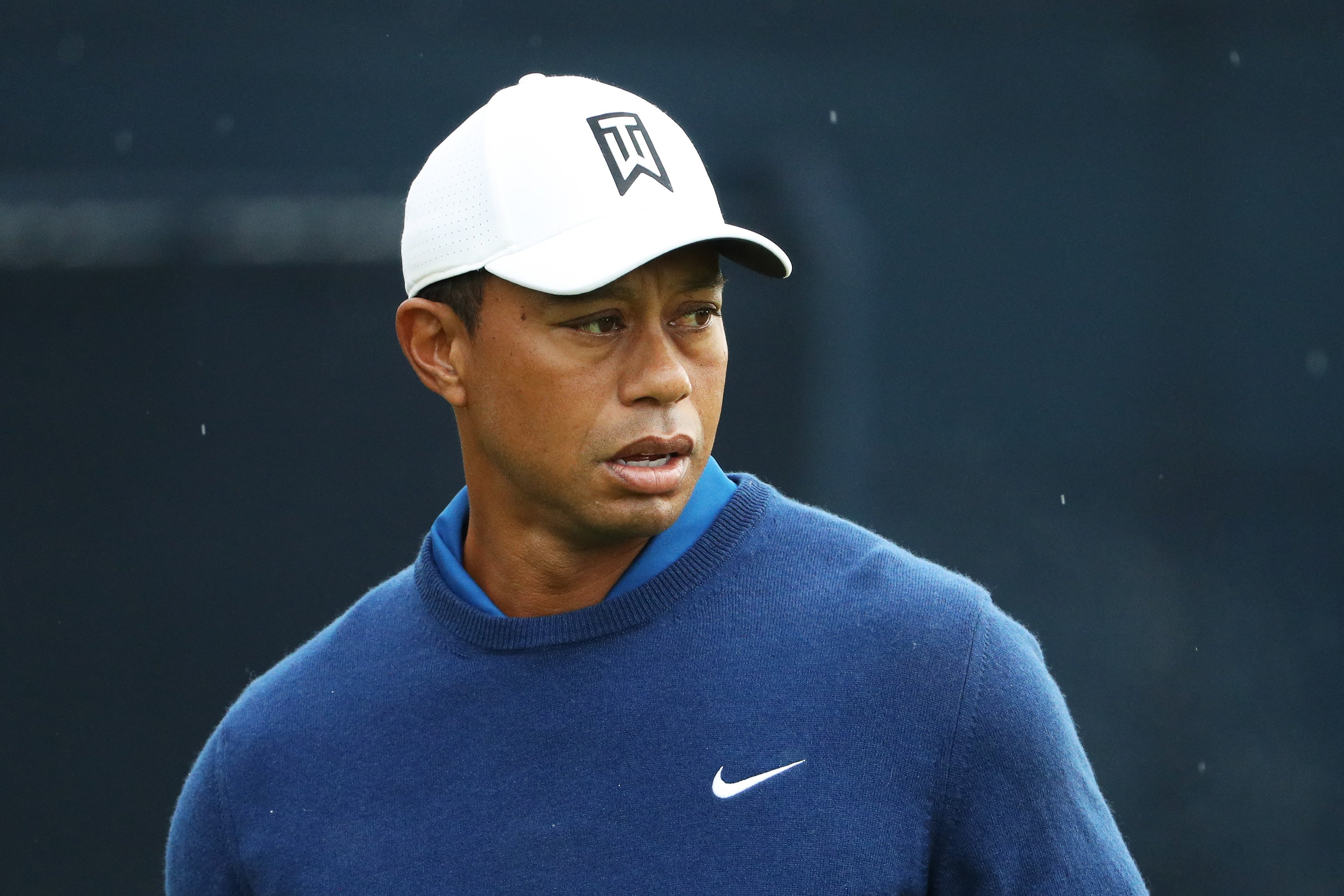 Image Credits: Getty Images / Patrick Smith | Tiger Woods of the United States warms up on the practice range during the first round of the 2019 PGA Championship at the Bethpage Black course on May 16, 2019 in Farmingdale, New York.