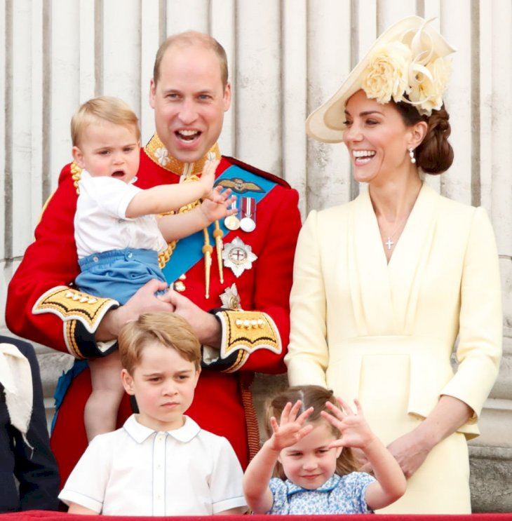 Image Credit: Getty Images / Prince William, Duke of Cambridge, Catherine, Duchess of Cambridge, Prince Louis of Cambridge, Prince George of Cambridge and Princess Charlotte of Cambridge watch a flypast from the balcony of Buckingham Palace.