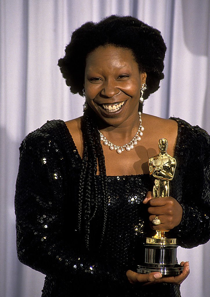 Image Credits: Getty Images / Ron Galella/Ron Galella Collection | Whoopi Goldberg holding her Oscar
