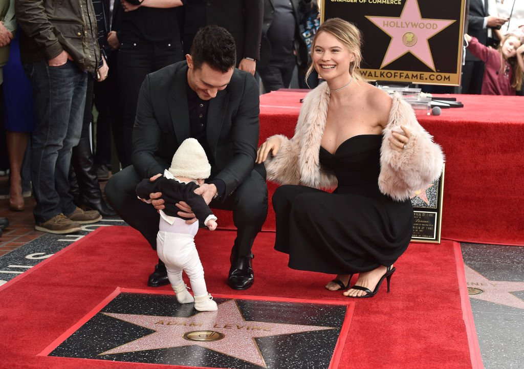 Image Credit: Getty Images / Adam Levine, model Behati Prinsloo and daughter Dusty Rose Levine attend the ceremony honoring Adam Levine with star on the Hollywood Walk of Fame on February 10, 2017.