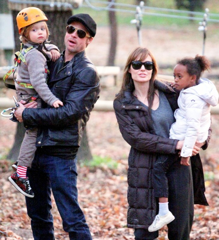 Image Credit: Shutterstock.com/Northfoto | Brad Pitt and Angelina Jolie take their children Pax, Zahara and Shiloh to a park in Budapest