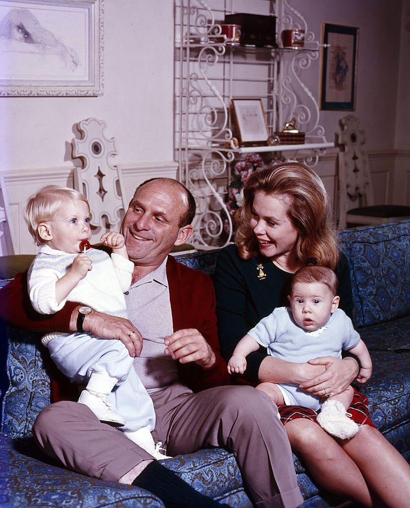Image Credits: Getty Images / Walt Disney Television | Elizabeth Montgomery with husband director William Asher, and sons Robert Deverell Asher and William Allen Asher, February 14, 1966.