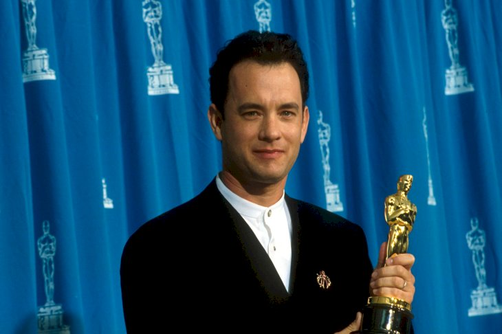 Image Credits: Getty Images / John Barr / Liaison | Actor Tom Hanks receives his Oscar at the Academy Awards in Los Angeles, CA., March 29, 1995.