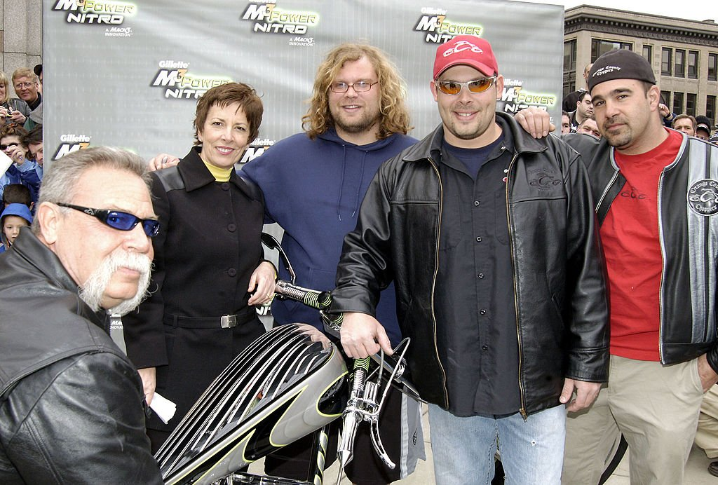 Image Credits: Getty Images / Bob Gevinski / WireImage | Paul Teutul Sr., Nichele Szynal, Mikey Teutul, Paul Teutul Jr. and Vinnie at the Orange Country Choppers presentation of the M3Power Nitro Chopper to Gillette.