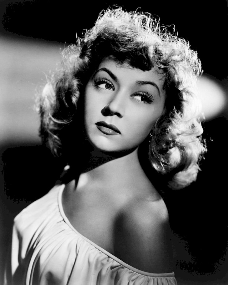 Image Credit: Getty Images/Silver Screen Collection | Gloria Grahame wearing an off-the shoulder dress, circa 1948.