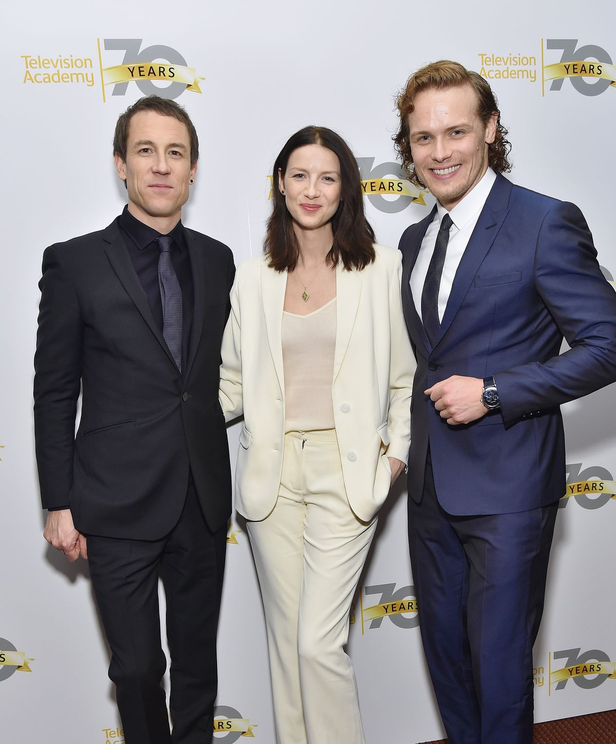 "Cast members Tobias Menzies, Caitriona Balfe and Sam Heughan pose during the Television Academy Presents ""Outlander"" Panel Discussion at NYU Skirball Center, 2016 in New York City/Photo:Getty Images"