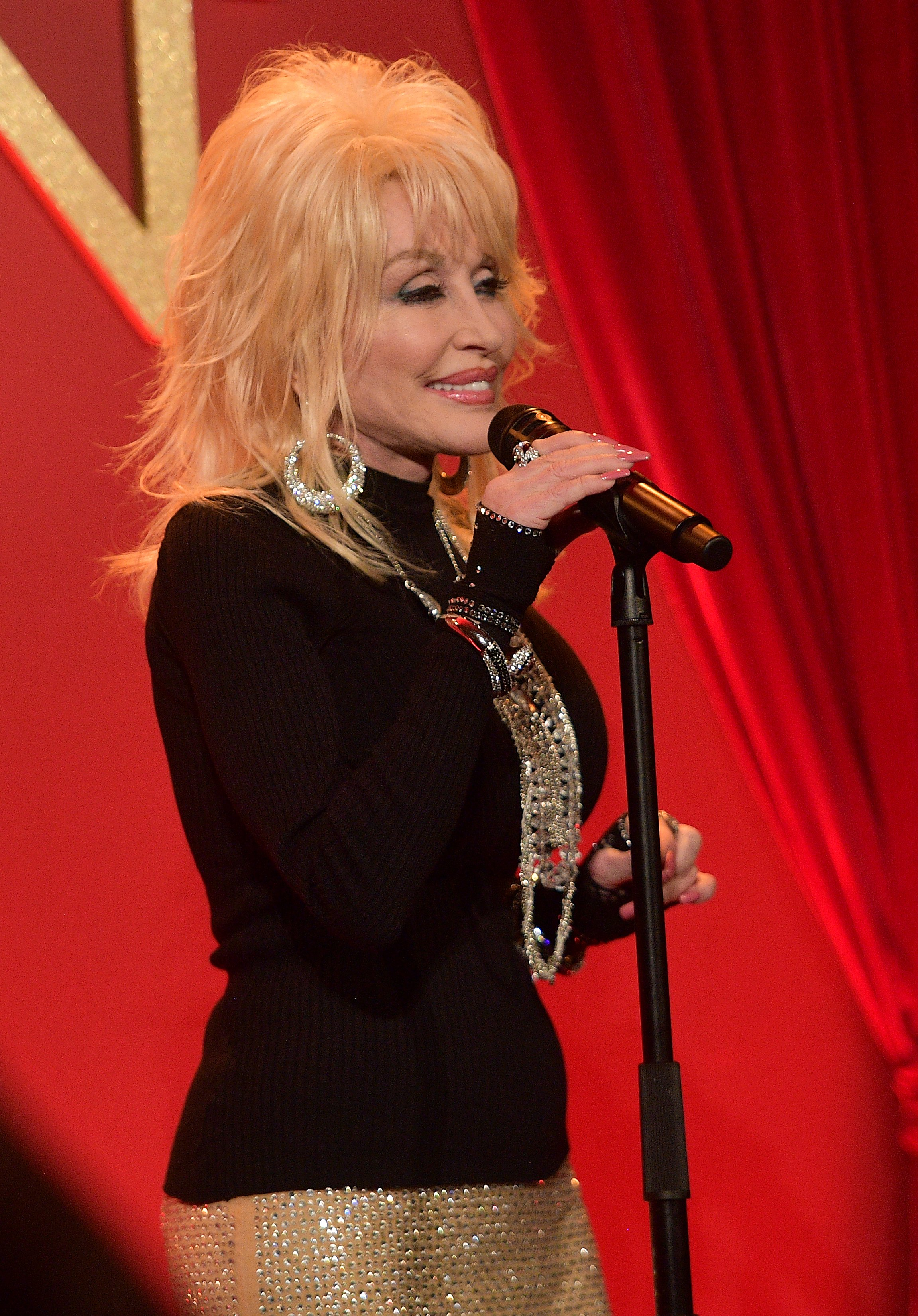 Image Credits: Getty Images / Matt Winkelmeyer | Dolly Parton performs onstage at a luncheon for the Netflix Film Dumplin' at Four Seasons Hotel Los Angeles at Beverly Hills on October 22, 2018 in Los Angeles, California.