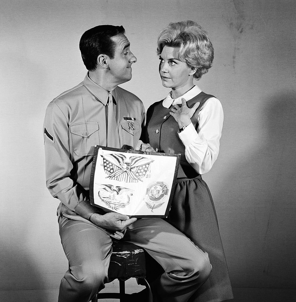 Image Source: Getty Images/CBS Photo Archive| American actors Jim Nabors (as Pvt. Gomer Pyle) and Elizabeth MacRae (as Lou Ann Poovie) during filming of an episode of the television comedy series 'Gomer Pyle, USMC' entitled 'A Tattoo For Gomer,' California, October 9, 1968