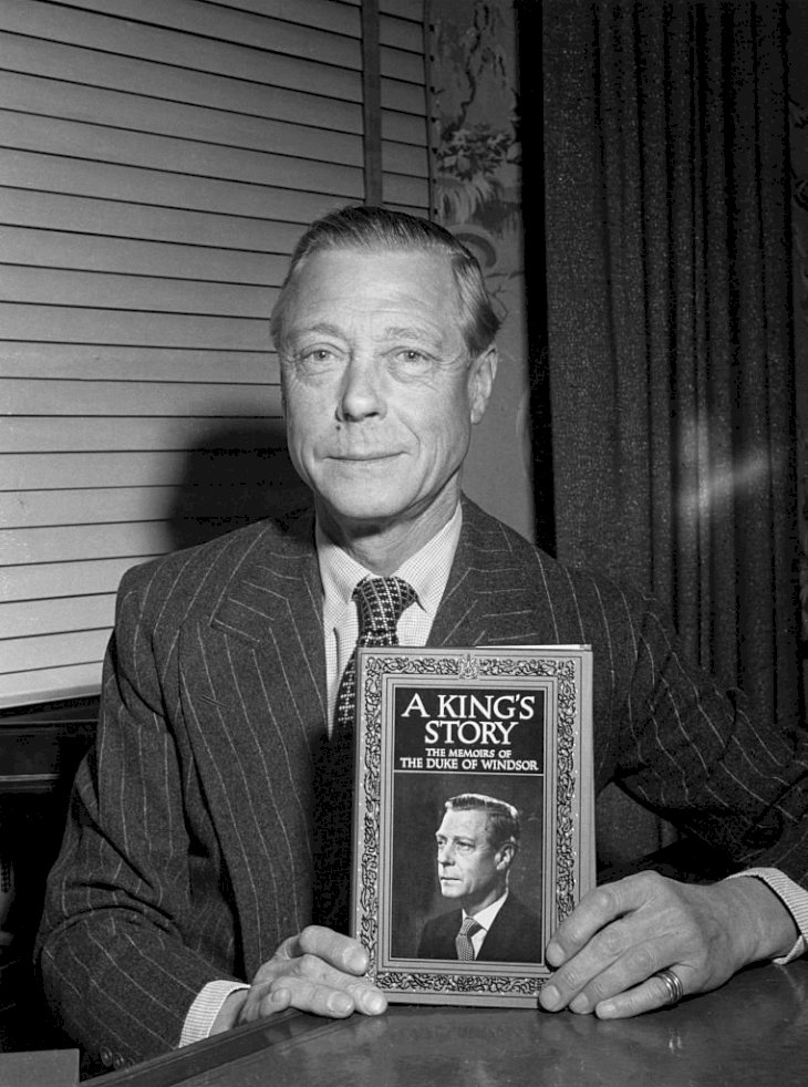 Image Credits: Getty Images - Erika Stone | The Duke of Windsor (1894 - 1972), formerly King Edward VIII, with his memoirs, entitled 'A King's Story: The Memoirs of the Duke of Windsor', circa 1951.