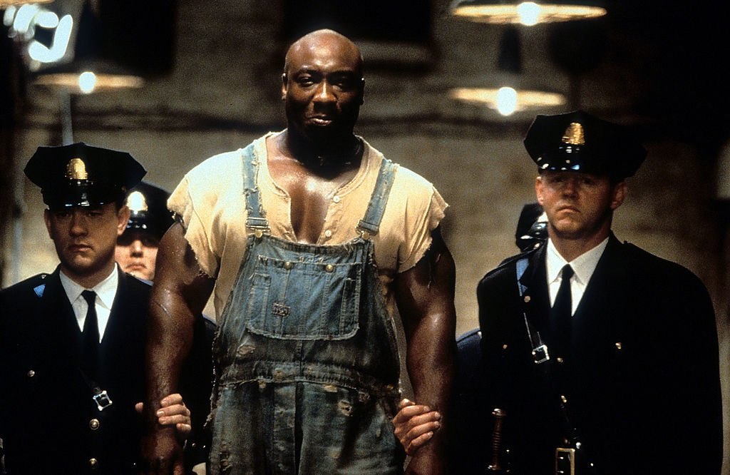 Image Credit: Getty Images / Michael Clarke Duncan is walked down a hall in a scene from the film 'The Green Mile', 1999.
