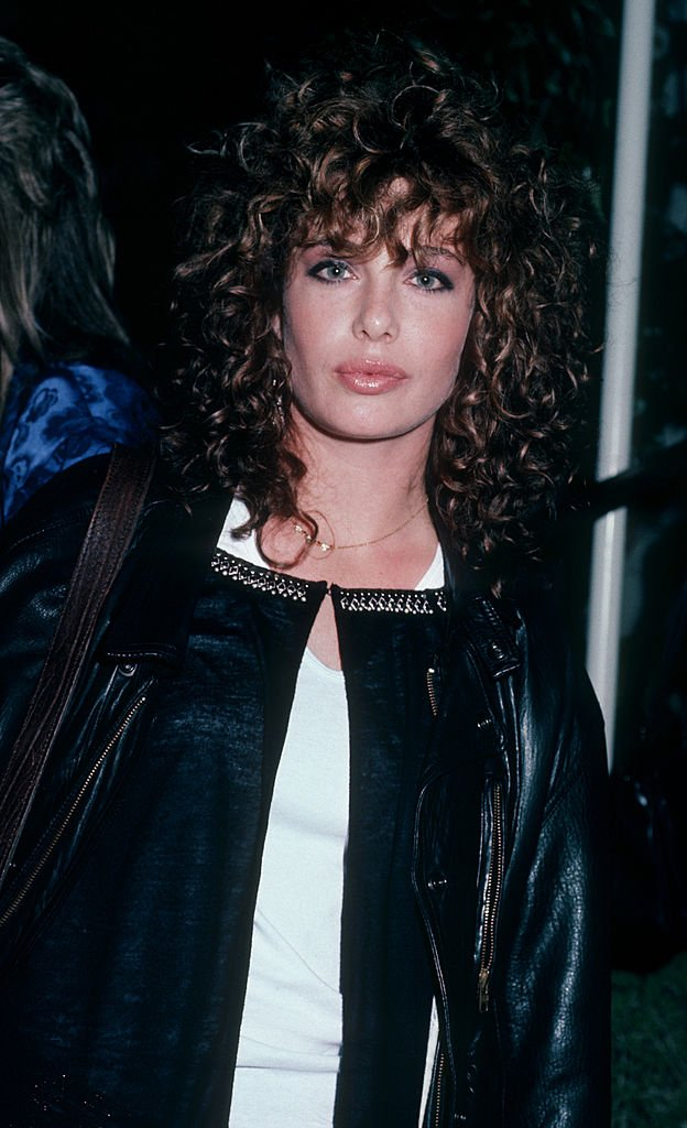 Image Credits: Getty Images / Ron Galella, Ltd. / Ron Galella Collection | Actress Kelly LeBrock being photographed on November 13, 1985 at Spago Restaurant in West Hollywood, California.