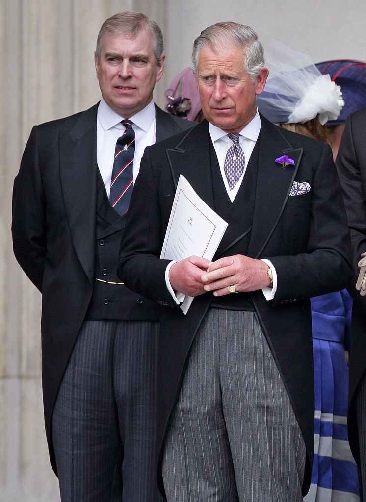 Image Source: Getty Images/ Prince Andrew and Prince Charles arriving at a formal event