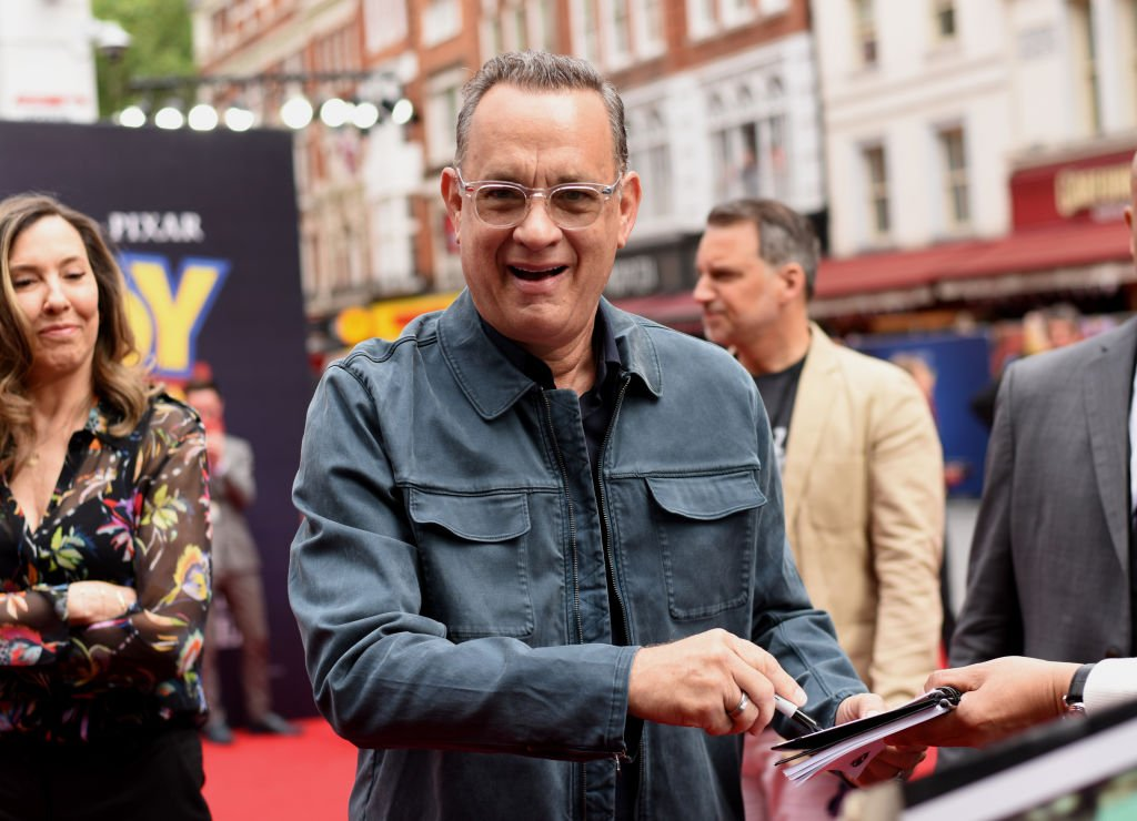 "Image Credits: Getty Images / Gareth Cattermole | Tom Hanks attends the European premiere of Disney and Pixar's ""Toy Story 4"" at the Odeon Luxe Leicester Square on June 16, 2019 in London, England."