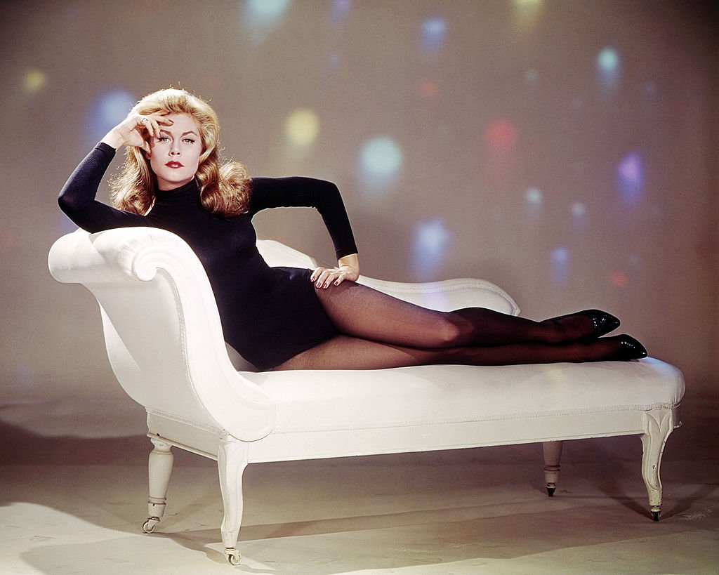 Image Credits: Getty Images / Silver Screen Collection | American actress Elizabeth Montgomery (1933 - 1995) wearing a black leotard and reclining on a chaise longue, circa 1967.