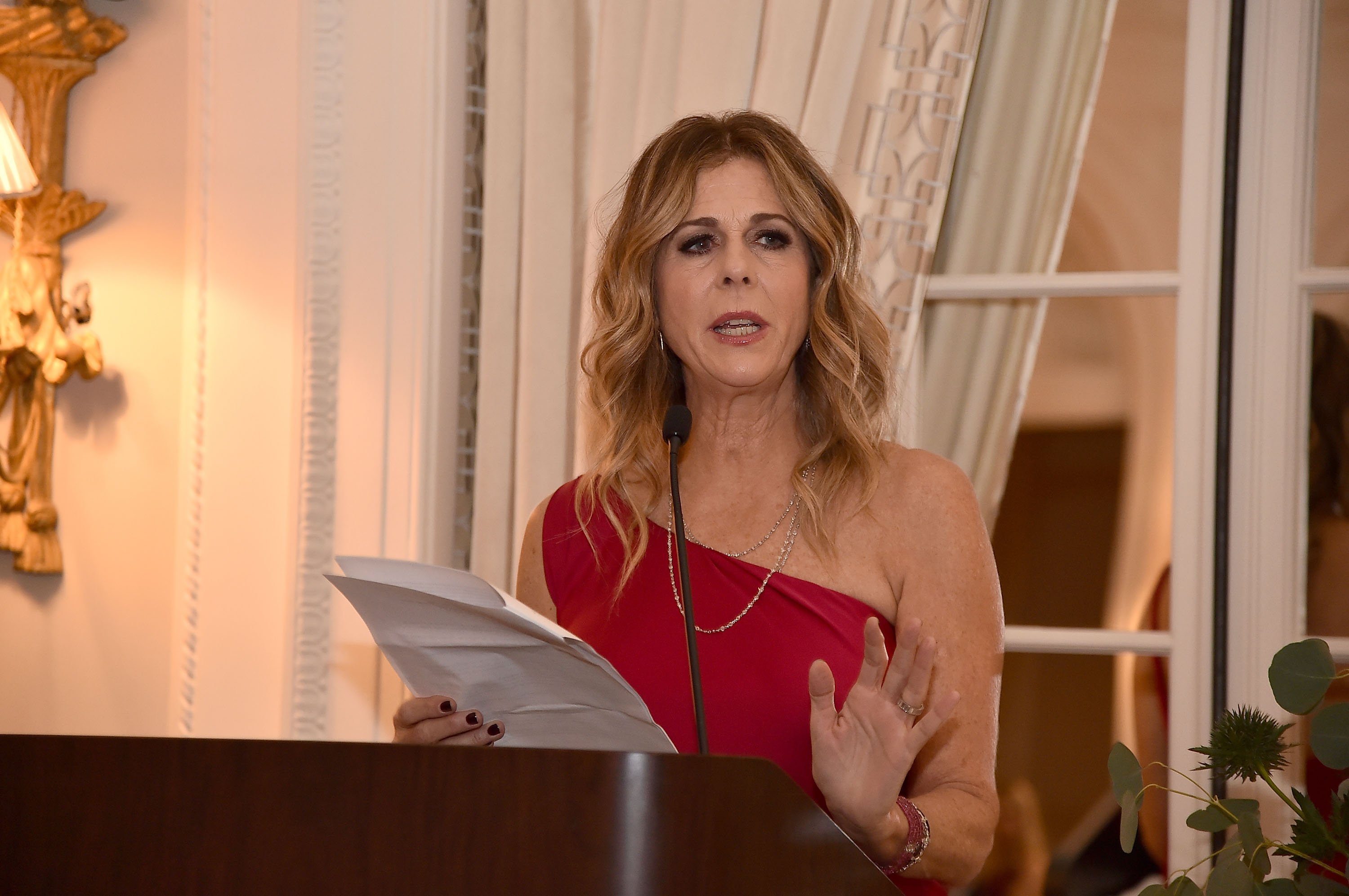 Image Credits: Getty Images / Theo Wargo | Rita Wilson speaks at the 2018 American Friends of Blerancourt Dinner on November 9, 2018 in New York City.