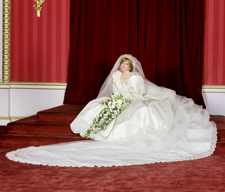 Image Credit: Getty Images/Lichfield Archive via Getty Images | Princess Diana poses with in her wedding dress